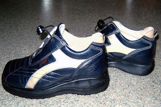 Schuherhöhung links 1 cm